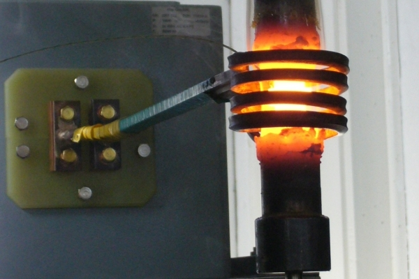 Induction heating of a specimen with a thermocouple