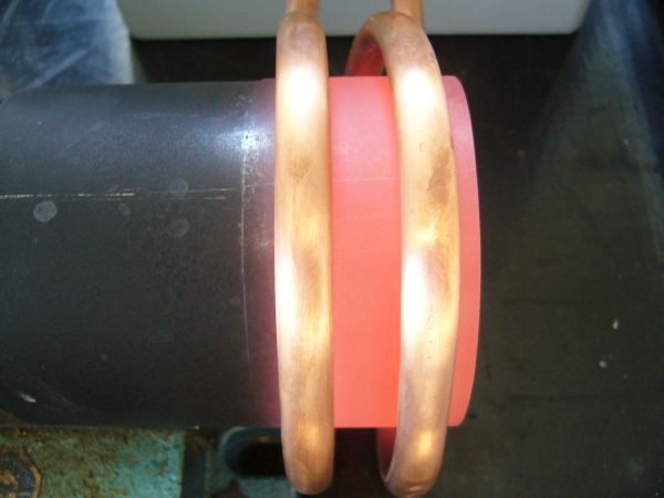 Continuous hardening of a tube